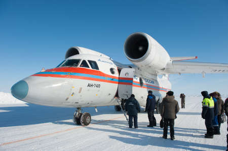arctic waters: Drifting ice floe is in the neutral waters of the Arctic Ocean - April 28, 2011: The Russian aircraft AN-74P MOE on an ice runway near the polar station SP-38  drifting on an ice floe in the area of North Pole Editorial