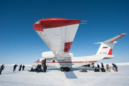 Drifting ice floe is in the neutral waters of the Arctic Ocean - April 28, 2011: The Russian aircraft AN-74P MOE on an ice runway near the polar station SP-38  drifting on an ice floe in the area of North Pole Redakční
