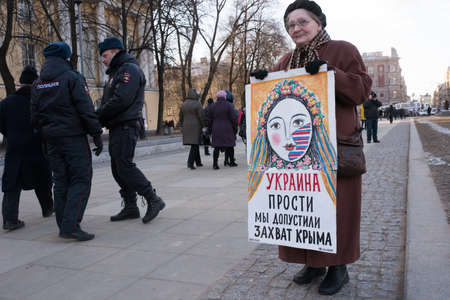 annexation: Saint-Petersburg, Russia - March 18, 2016: the rally on the occasion of the second anniversary of the reunion of Crimea to Russia, Pickets against the annexation of Crimea to Russia.