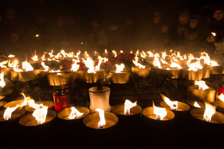 """Saint-Petersburg, Russia - March 19, 2016: Global action """"Earth Day."""" Flashmob with candles in the historic center of the city. People hold candles in their hands in the evening."""