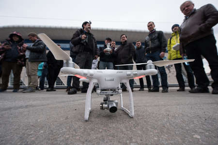 Saint-Petersburg, Russia - March 26, 2016: People learn to control unmanned aerial vehicles - drones with the help of experienced users Phantom Series device Editorial