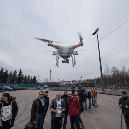 airborne vehicle: Saint-Petersburg, Russia - March 26, 2016: People learn to control unmanned aerial vehicles - drones with the help of experienced users Phantom Series device Editorial