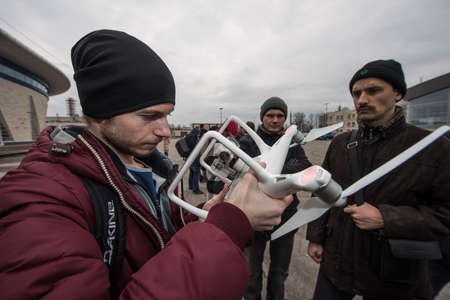 Saint-Petersburg, Russia - March 26, 2016: People learn to control unmanned aerial vehicles - drones with the help of experienced users Phantom Series device Editoriali