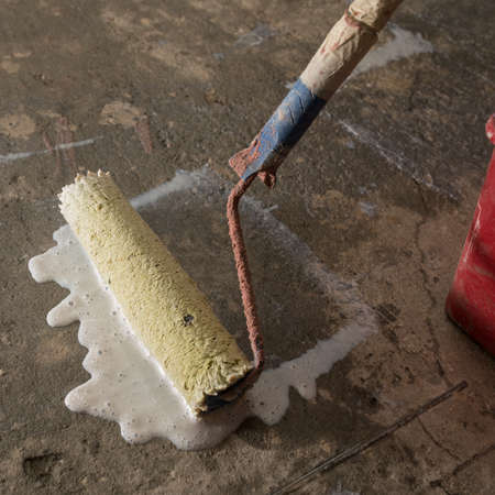 preparatory: Priming Concrete floor before laying tiles on it, the final preparatory stage for strengthening the surface