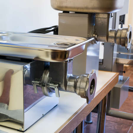kilograms: Big electric grinder for processing large quantities of meat in restaurants and small eateries. It processes more than 30 kilograms of meat per hour. Stock Photo