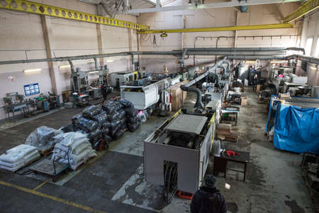 Saint-Petersburg, Russia - March 23, 2016: Aerial view of the machine factory production line. A number of automated lathes and milling machines. Editoriali