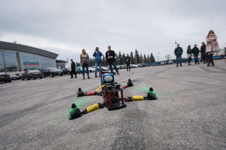 maneuverable: Saint-Petersburg, Russia - March 26, 2016: Flying drone assembled on their own. Trial starts drone to drone on racing competitions.