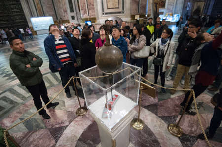 public demonstration: Saint-Petersburg, Russia - April 12, 2016: Public demonstration of the Foucault pendulum in St. Isaacs Cathedral.  The pendulum was installed in 1932 to demonstrate the rotation of the Earth. Editorial