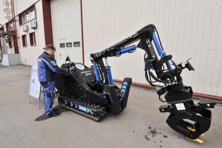 radiation protection suit: Saint-Petersburg, Russia - April 6, 2016: Robotics complex is designed for remote installation demolition, rescue special missions in the liquidation of the radiation accident Editorial