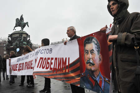 dictator: ST. PETERSBURG, RUSSIA - MAY1: During the celebration of May Day. Communist party supporters take part in a rally in May 1, 2010. Portrait of Soviet dictator Josef Stalin