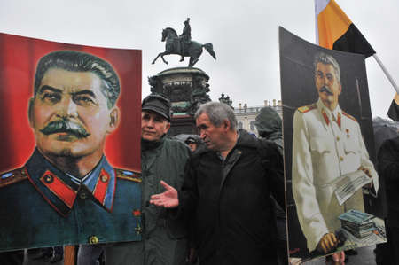 josef: ST. PETERSBURG, RUSSIA - MAY1: During the celebration of May Day. Communist party supporters take part in a rally in May 1, 2010. Portrait of Soviet dictator Josef Stalin
