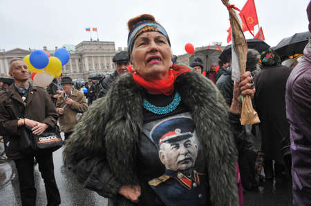 dictator: ST. PETERSBURG, RUSSIA - MAY1: Woman with a portrait of the Russian dictator Stalin T-shirt during a May Day demonstration on St. Isaacs square opposite the Mariinsky Palace in May 1, 2010