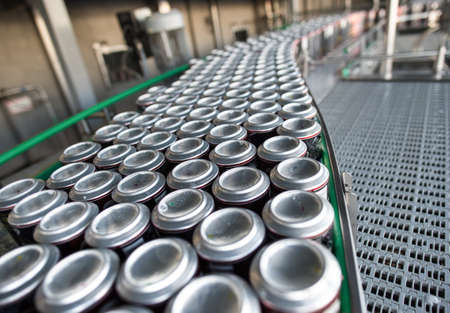 Stain-roof jars with drinks on the assembly line. for the production of alcoholic and soft drinks line. The final stage in the manufacture of the product.
