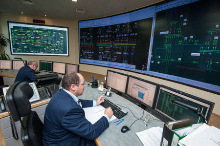 director de escuela: Saint-Petersburg, Russia - September 22, 2016: Control Point City energy company. Managers control the distribution of energy flows on areas of large cities on the power grid.