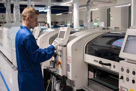 workmanship: Saint-Petersburg, Russia - November 2, 2016: Manufacturer of automotive security systems Starline. Engineering controls workmanship card chip.
