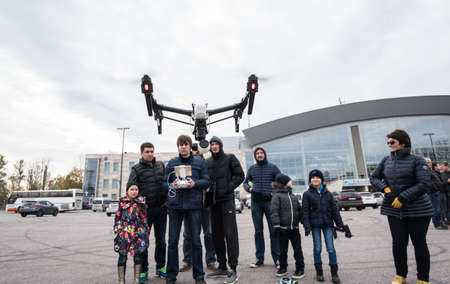 town square: Saint-Petersburg, Russia - October 17, 2015: People in the town square drones learn to manage with the help of remote controls Editorial