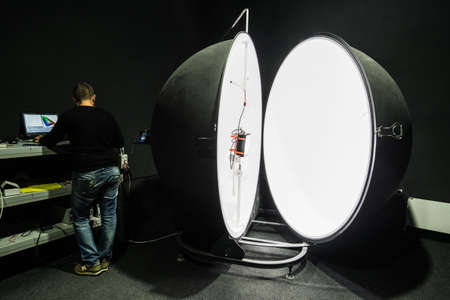 Saint-Petersburg, Russia - November 30, 2016: Integrating sphere photometer ball in the enterprise laboratories for the study of the characteristics of light and technical devices Editorial