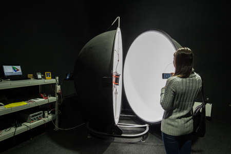 irradiation: Saint-Petersburg, Russia - November 30, 2016: Integrating sphere photometer ball in the enterprise laboratories for the study of the characteristics of light and technical devices Editorial