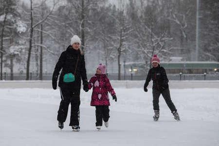 frostily: Saint-Petersburg, Russia - December 2, 2016: Urban outdoor ice rink in the park.