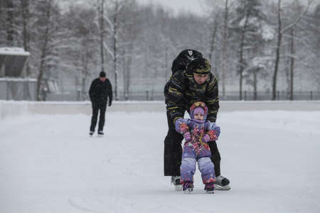 icily: Saint-Petersburg, Russia - December 2, 2016: Urban outdoor ice rink in the park.