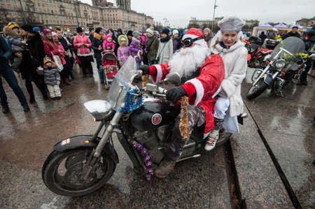 Saint-Petersburg, Russia - December 25, 2015: Santa Claus and Snow Maiden ride on a motorcycle on the central streets and squares of the city.
