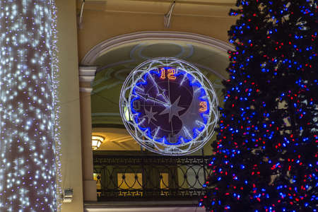 led lighting: Decorated with multicolored diodes for Christmas clock on the wall of a building