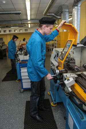 vocational: Saint-Petersburg, Russia - February 16, 2012: Students of the vocational school is working on a lathe in the workshop machine factory during manufacturing practices