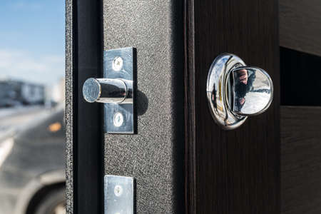 spying: Metal apartment entrance door burglar sdelanaya by special technology. View of the door lock from the end of a close-up. Stock Photo