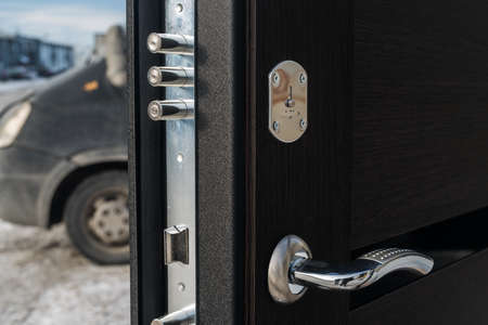 hasp: Metal apartment entrance door burglar sdelanaya by special technology. View of the door lock from the end of a close-up. Stock Photo