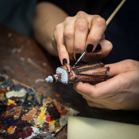 Saint-Petersburg, Russia - February 21, 2017: A small factory producing small batches pewter figurines.  painting the figure of a nobleman