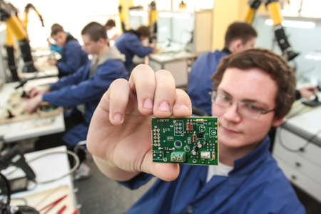 St. Petersburg, Russia - February 16, 2012: Electrotechnical College of Municipal Economy. Students study microcircuits for microelectronics classes.
