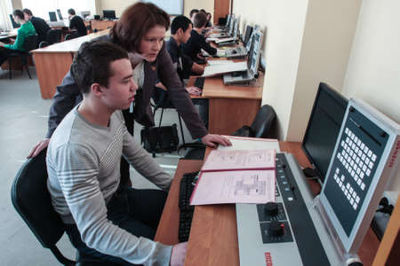 St. Petersburg, Russia - February 16, 2012: The teacher checks the accuracy of the assignment by the student of the electrotechnical college in the classroom
