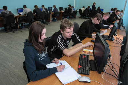 St. Petersburg, Russia - February 16, 2012: Students of the electrical engineering college after completing the exam task in the classroom before the computer monitors. Éditoriale