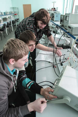 St. Petersburg, Russia - February 16, 2012: Students of Electrotechnical College during laboratory tests with an ascendant and desktop monitors.