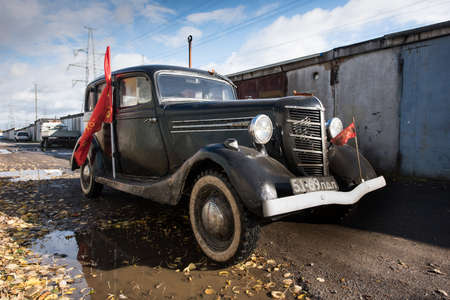 St. Petersburg, Russia - October 1, 2016: Soviet Retrocar GAZ-M-1 Emka years of production 1936-1943. Was copied from Fords lineup.The car moves and overcomes puddles. Editöryel