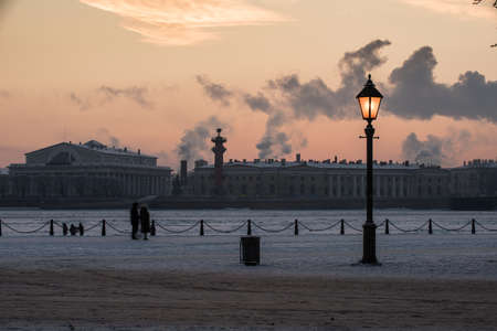 St. Petersburg. Russia. Evening view of the city. Arrow of the Vasilyevsky Island, Rosstralnye columns, building of the exchange. Night street lamp. Stock Photo