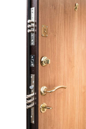 Metal apartment entrance door pasted with wooden veneer. View from the butt. Castle with pins in closed form. Stock Photo