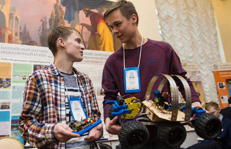 St. Petersburg, Russia - February 7, 2018: The XIV Baltic Scientific Engineering Contest (BNIK). Young talented children, schoolchildren presented their inventions to the jury. Two boys discuss the merits of the current all-terrain vehicle model.