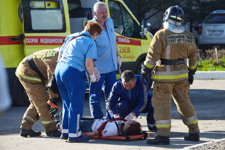 St. Petersburg, Russia - May 12, 2018: contest / exercises on first aid at the pre-hospital stage. Firemen carry out on stretchers the victim during a fire on the plane. Editorial