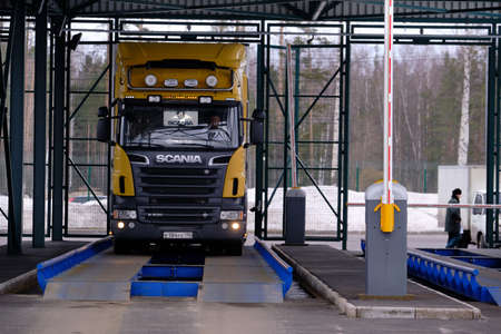 St. Petersburg, Russia - March 22, 2019: Entrance to the customs territory. Car Scania on the weight control before customs clearance of goods.