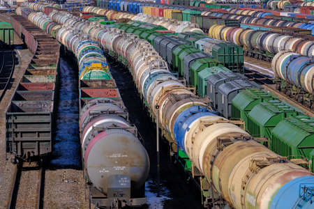 St. Petersburg, Russia - March 27, 2019: Top view of the sorting railway station for freight transport. Freight cars during sorting. Industrial transport of various goods.