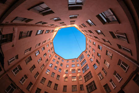 One of the courtyards - wells in St. Petersburg. Typical architecture of the city of the late 19th century. The shape of the courtyard in the form of an octagon. Nontraditional tourist route Stock Photo