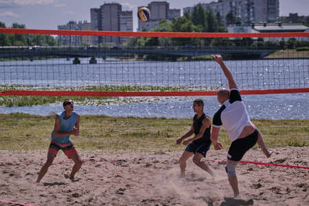 St. Petersburg, Russia-June 30, 2019: Beach volleyball game on the river bank in the park during the urban youth festival. Game moment. Editöryel