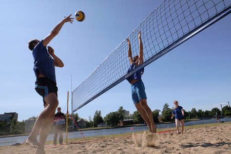 St. Petersburg, Russia-June 30, 2019: Amateur beach volleyball. Competitions at the city festival. Affiliate friendly game. Acute moment.