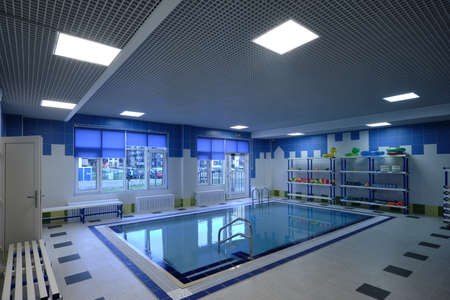 St. Petersburg, Russia - November 01, 2019: Childrens beautiful pool filled with water in a childrens preschool municipal educational institution. Mostly blue, clear water. Modern design. Редакционное