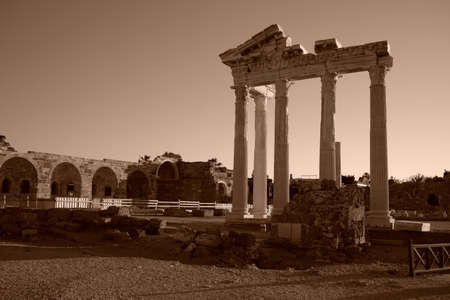 The most famous monument in Side is the Temple of Apollo, in the morning soft light. The main attraction of the city and Turkey. View of the Mediterranean Sea. The gentle light of the sky Monochrome, Sepia Banco de Imagens