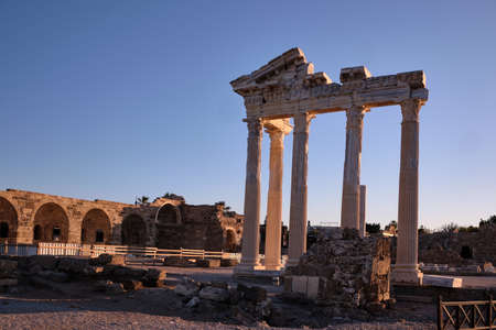 The most famous monument in Side is the Temple of Apollo, in the morning soft light. The main attraction of the city and Turkey. View of the Mediterranean Sea. The gentle light of the sky.