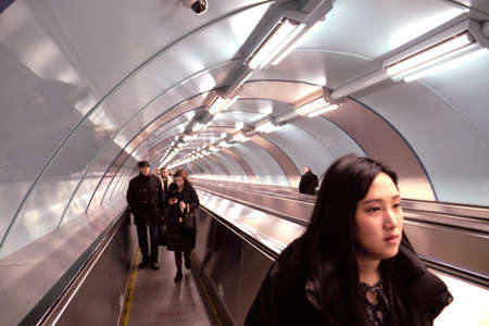 St. Petersburg, Russia - December 12, 2019: Passengers on the steps of a new travelator in the underground part of the city subway. Great modern, beautiful design Editorial