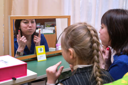 St. Petersburg, Russia - February 27, 2020: A speech therapist specialist conducts speech correction classes in a children's preschool specialized institution. The correct pronunciation of sounds