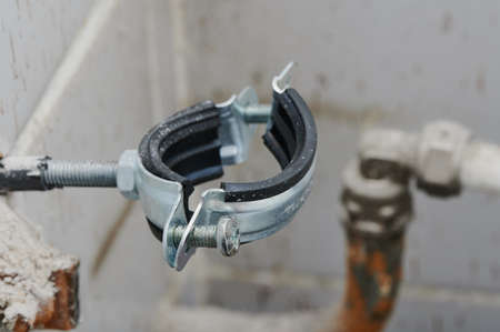 The clamp is plumbing, with a rubber gasket installed in a real situation. Screws, bolt, steel, rubberized, reliable during renovation in the apartment